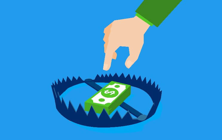 Payday loans can be dangerous, illustrated by a bear trap with money in the center, tempting a reaching hand.